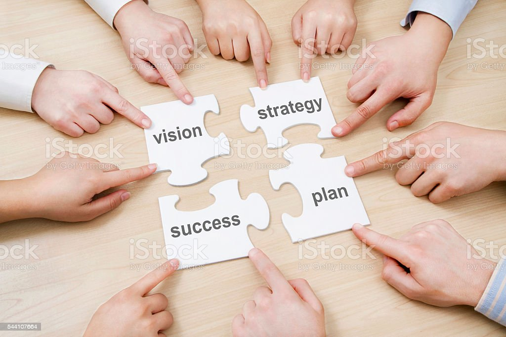 Puzzle Pieces with Business Related Words stock photo