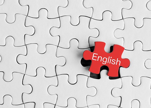 Puzzle pieces with word 'English'