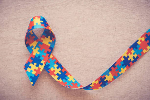 puzzle ribbon for autism awareness stock photo