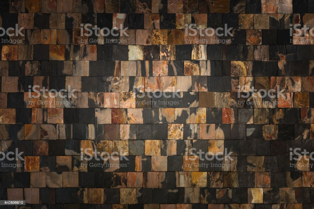 Puzzle stone wall background and texture, Surrounding black stone wall for background stock photo