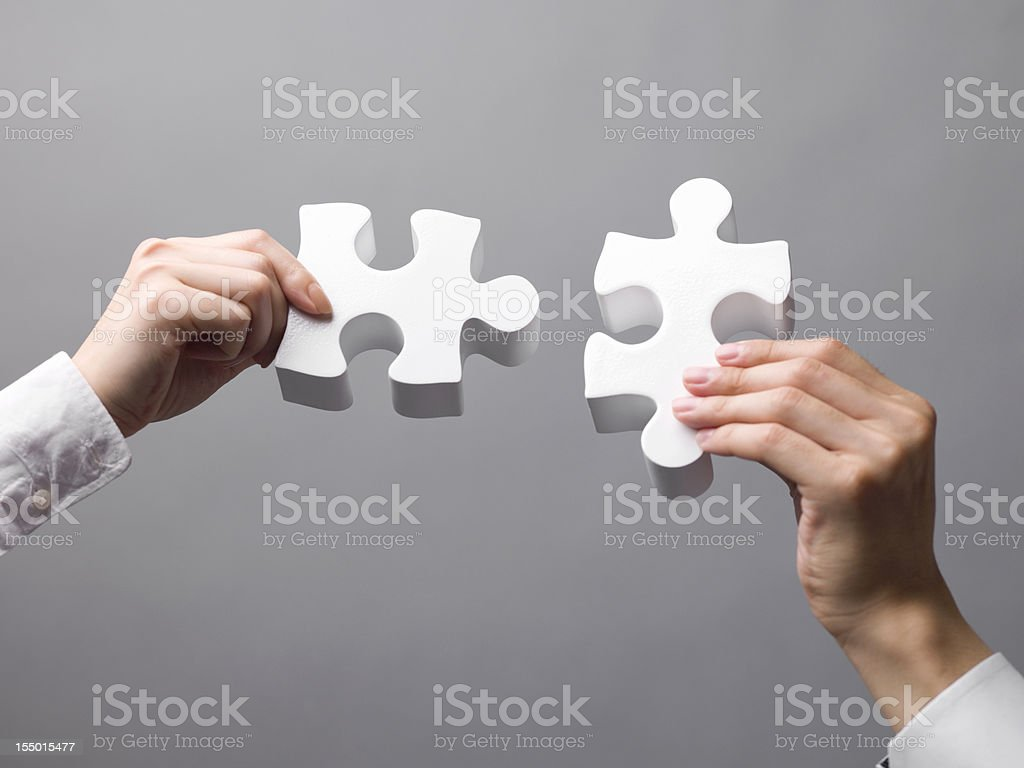 Puzzle with two hands royalty-free stock photo