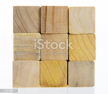 1134528355 istock photo Puzzle wooden cube on white background 1132295071