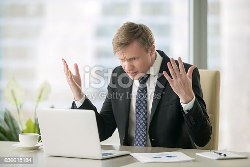 istock Puzzled businessman in office 636615184