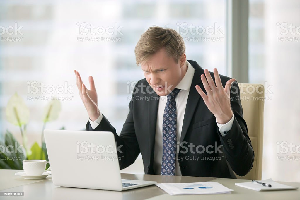 Puzzled businessman in office stock photo