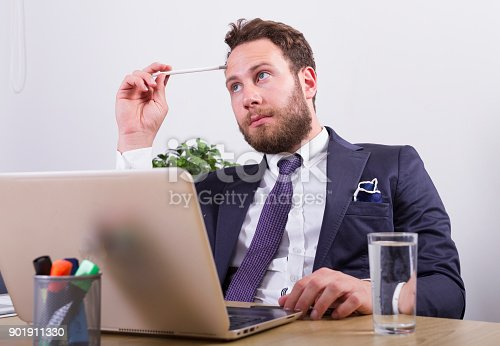 istock Puzzled businessman in office 901911330
