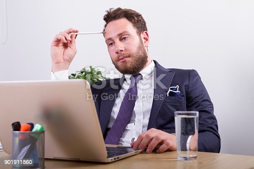 833210686 istock photo Puzzled businessman in office 901911860