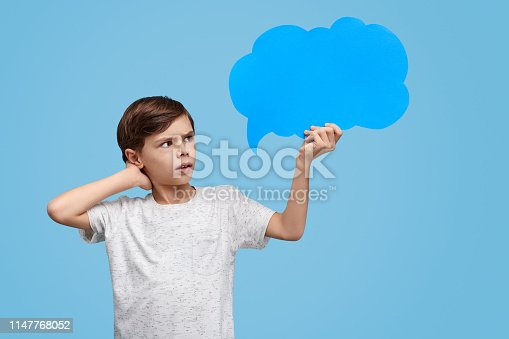 istock Puzzled kid looking at clear speech bubble 1147768052