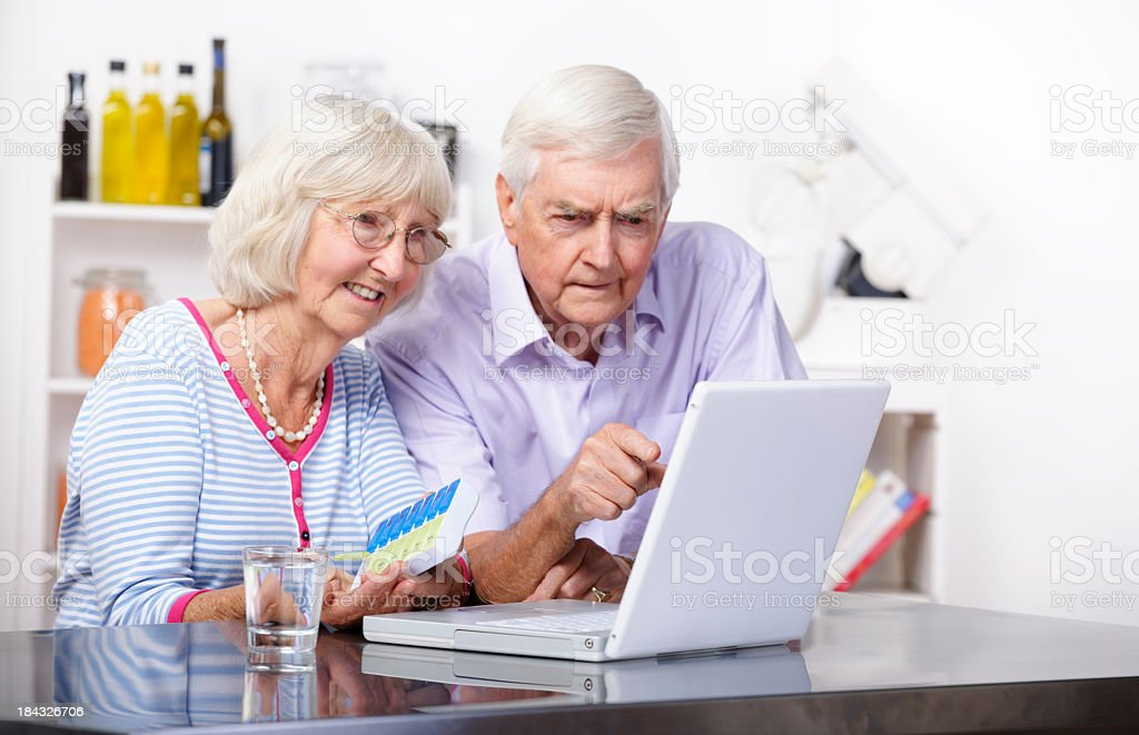 Puzzled Senior Reviewing Online Drug Information/ Prescription royalty-free stock photo
