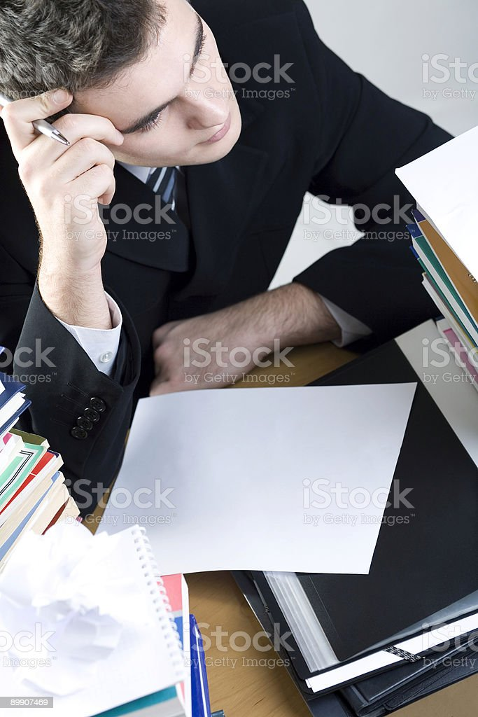 Puzzled student or businessman with blank paper royalty-free stock photo