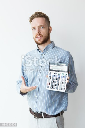 istock Puzzled Young Manager with Calculator 894333608