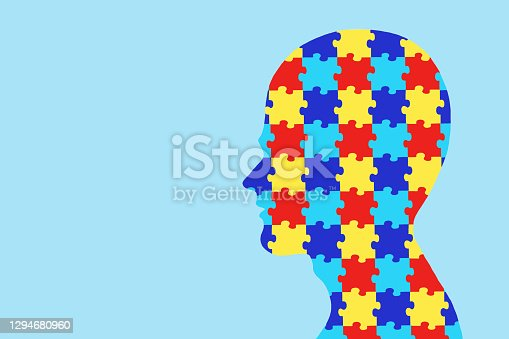 Puzzles in the human head. World Autism Awareness Day concept. Copy space. Flat lay.
