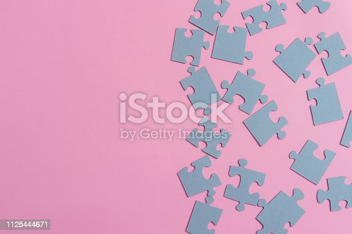istock Puzzles on a pink background as a symbol of autism. Conceptual vision of the problem of autistic children 1125444671