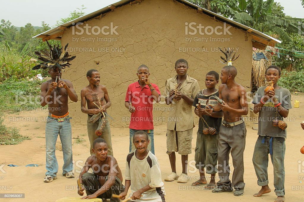 Pygmies are dancing in the village. stock photo