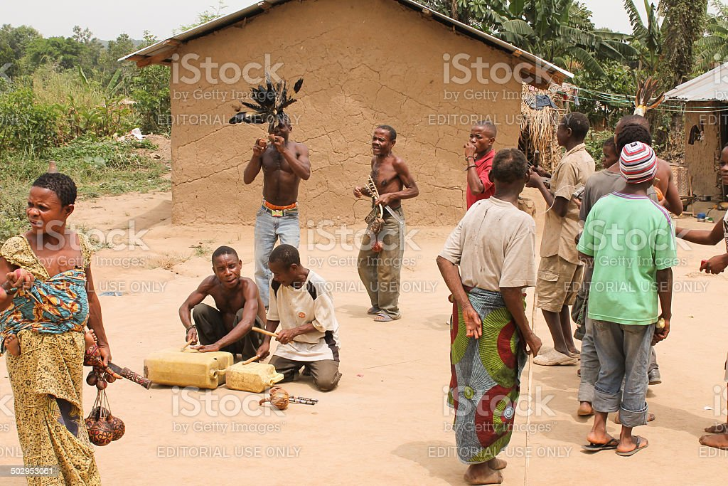 Pygmies dancing and playing on the cans. stock photo