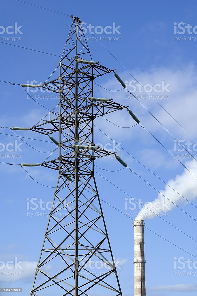 Pylon and factory pipe royalty-free stock photo