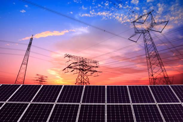 Pylon and photovoltaic panels stock photo