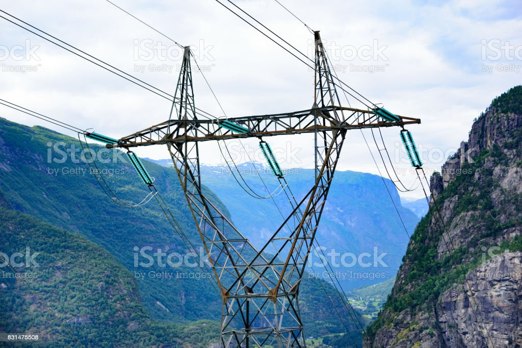 Pylon in mountains, power cables and glaicer in background stock photo