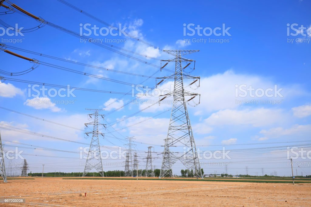 Pylon under the blue sky white clouds stock photo