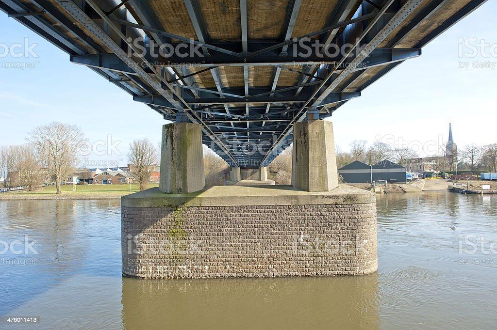 Pylons of highway bridge over river stock photo