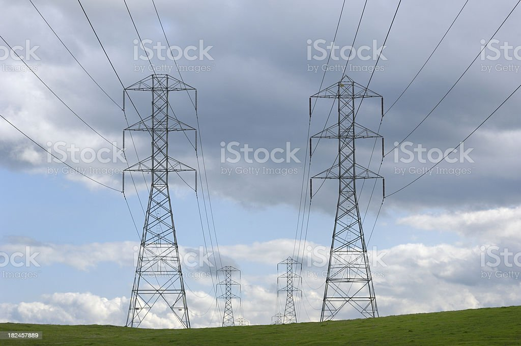 Pylons, Power Lines and Clouds royalty-free stock photo