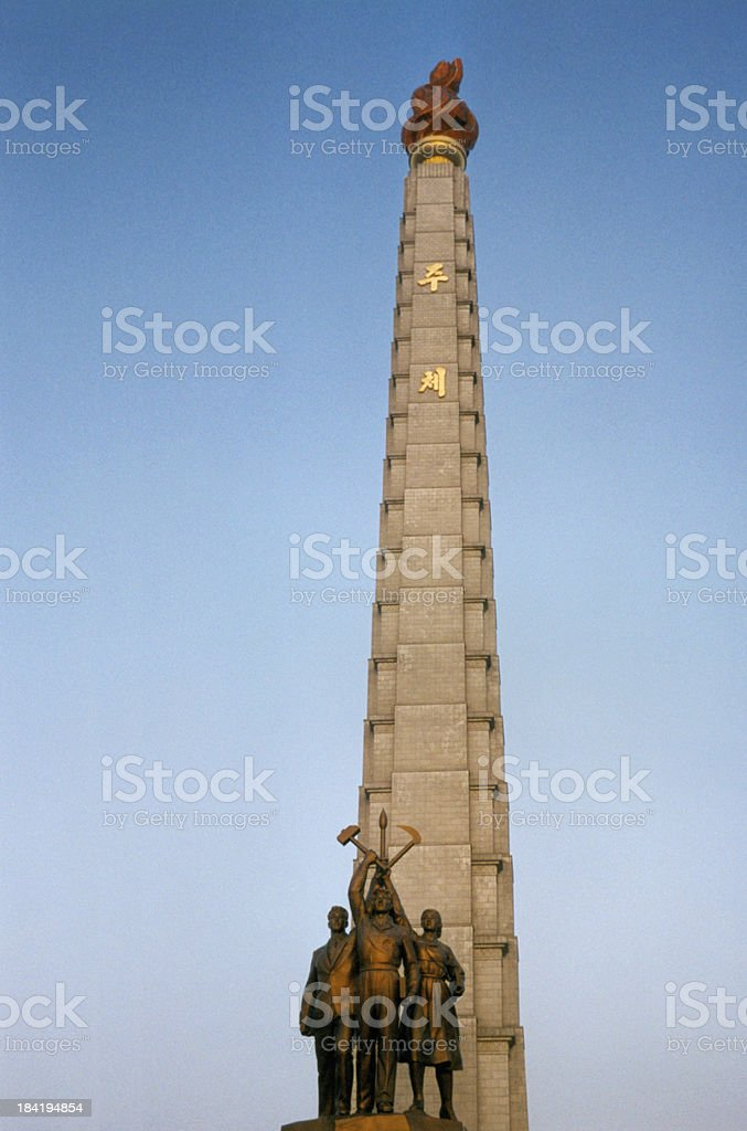 Pyongyang, North Korea: Juche Tower with central statues stock photo