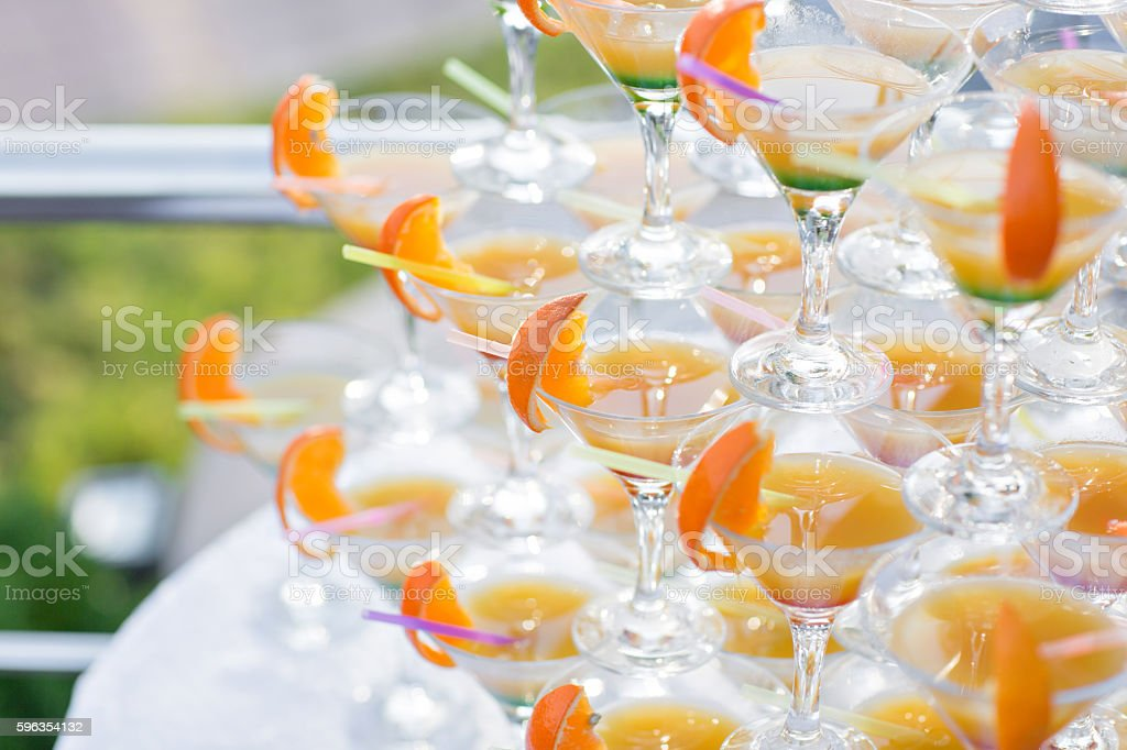 Pyramid from glasses at celebration. Colorful cocktails close up. an royalty-free stock photo