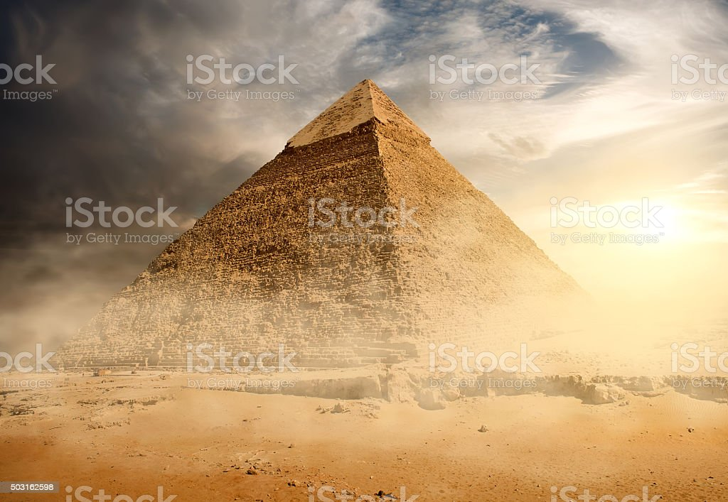 Pyramid in sand dust stock photo