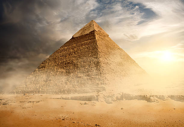 pyramid in sand dust - pyramid stock photos and pictures