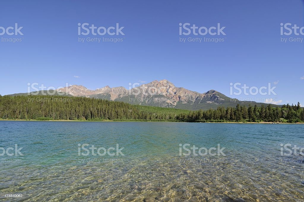 Pyramid Lake with Pyramid Mountain in the background stock photo