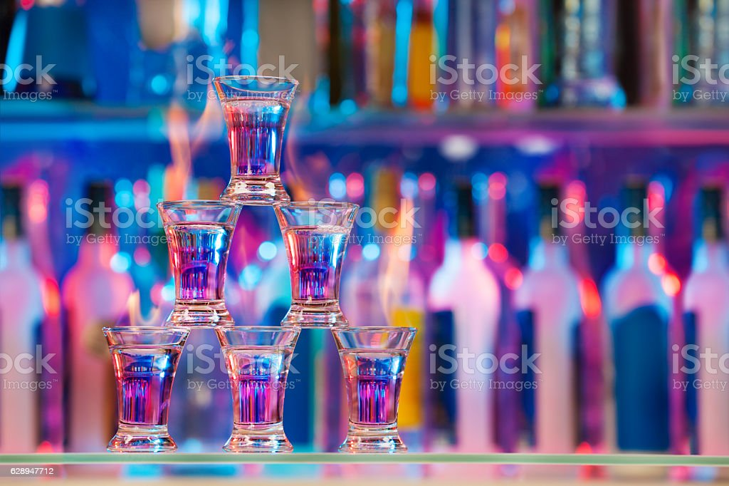 Pyramid line of burning alcohol cocktails stock photo