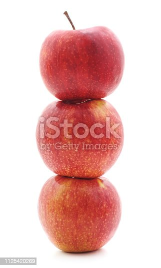 Pyramid of apples isolated on a white background.