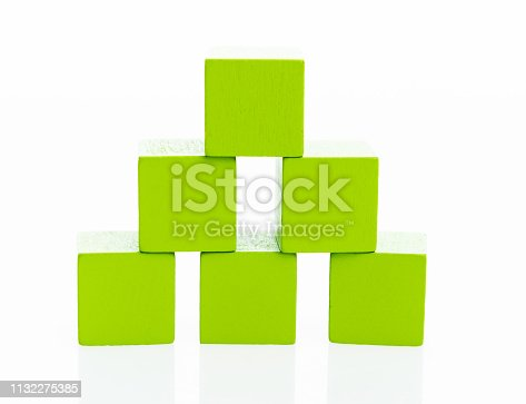 1134528355 istock photo Pyramid of blocks on white background 1132275385