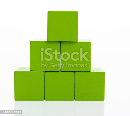 1134528355 istock photo Pyramid of blocks on white background 1132275539