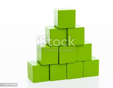 1134528355 istock photo Pyramid of blocks on white background 1132276358