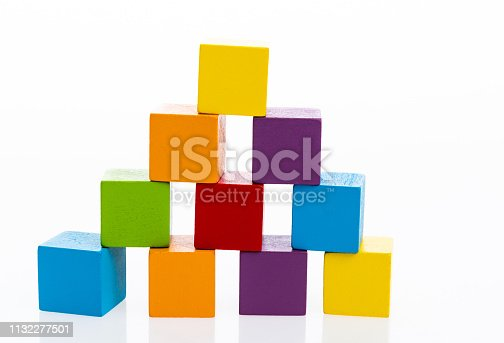 1134528355 istock photo Pyramid of blocks on white background 1132277501