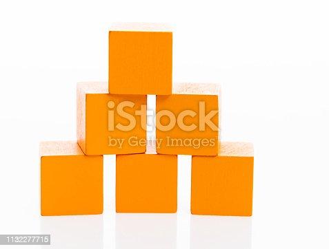 173937666 istock photo Pyramid of blocks on white background 1132277715