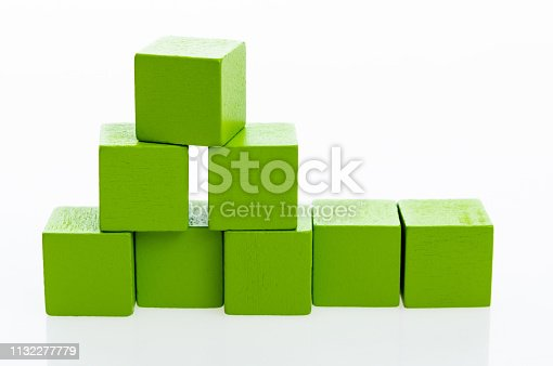 1134528355 istock photo Pyramid of blocks on white background 1132277779