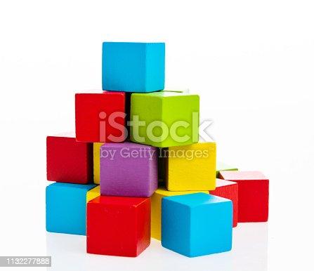 173937666 istock photo Pyramid of blocks on white background 1132277888