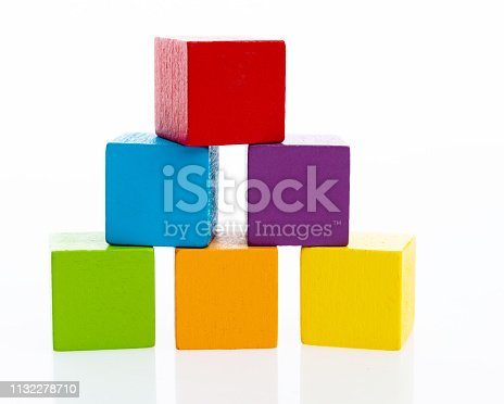 1134528355 istock photo Pyramid of blocks on white background 1132278710