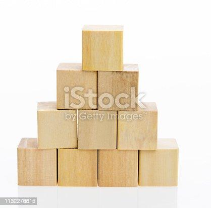173937666 istock photo Pyramid of blocks on white background 1132278815