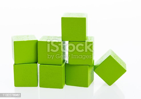 1134528355 istock photo Pyramid of blocks on white background 1132278982