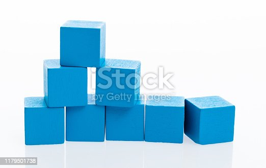 1134528355 istock photo Pyramid of blocks on white background 1179501738