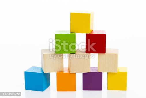 1134528355 istock photo Pyramid of blocks on white background 1179501758