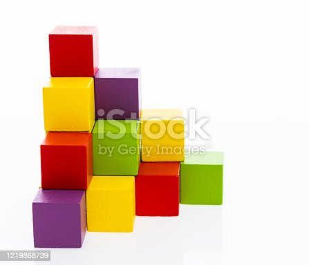 1134528355 istock photo Pyramid of blocks on white background 1219868739
