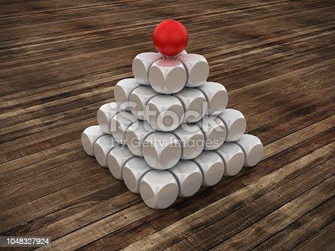 istock Pyramid of Blocks on Wood Floor One Red Sphere on Top - 3D Rendering 1048327924