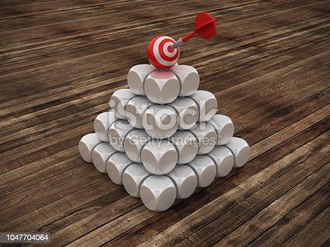 istock Pyramid of Blocks with Target on Top on Wood Floor - 3D Rendering 1047704064
