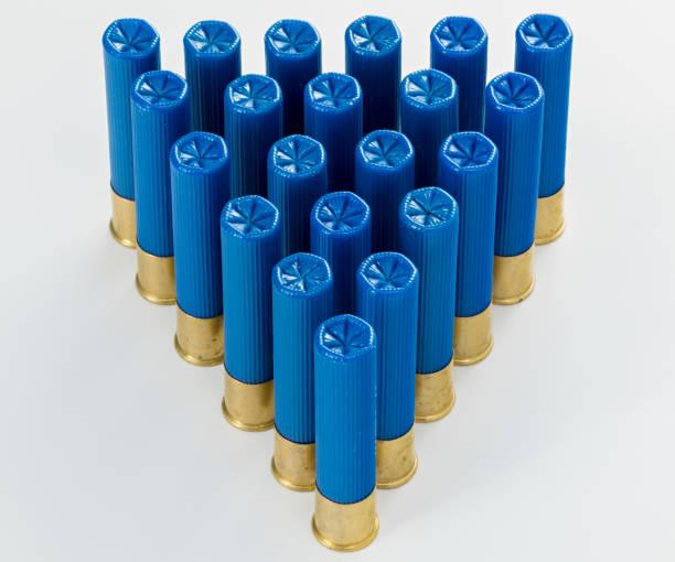 Pyramid of blue 410 gauge shotgun shells in a pattern stock photo