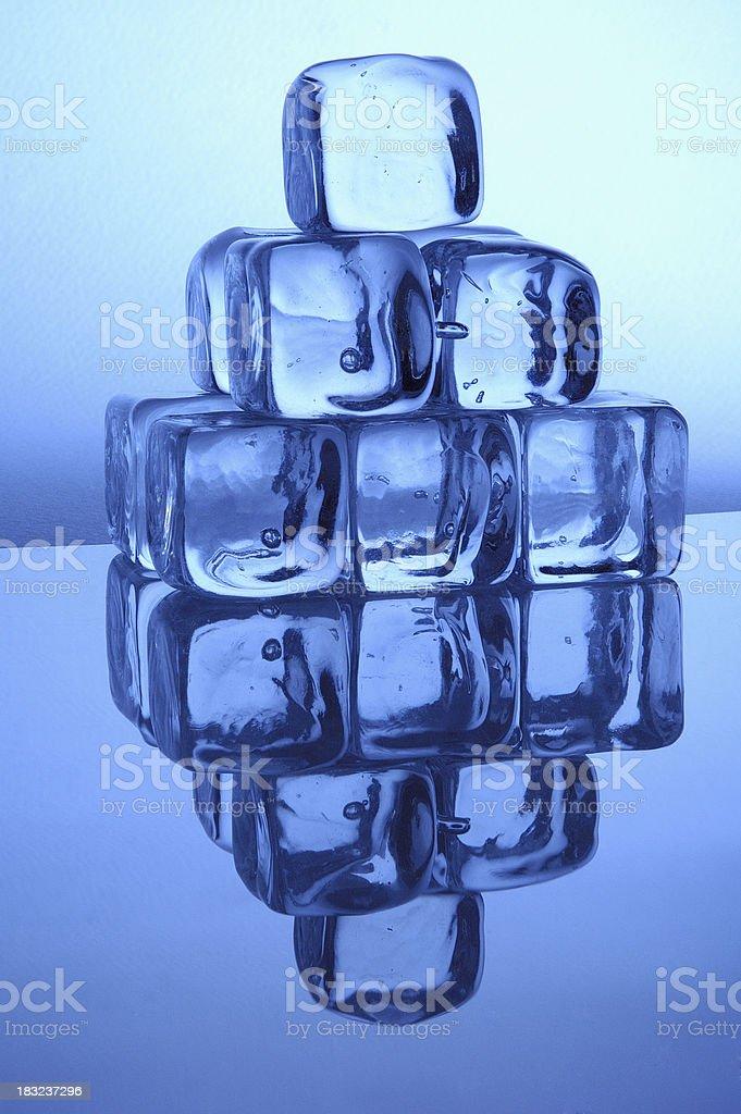 pyramid of blue ice cubes stock photo