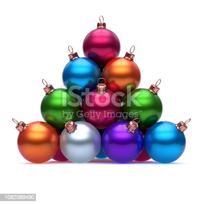67f7139ae1f Feliz año nuevo chucherías 1082093338 · 1082093338istock Pirámide de Navidad  las bolas de colores rojo azul naranja verde púrpura 1082089490