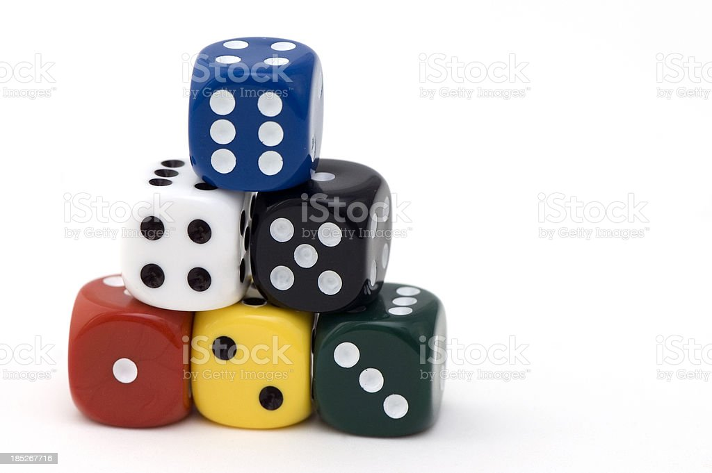Pyramid of Colored Six Dices stock photo
